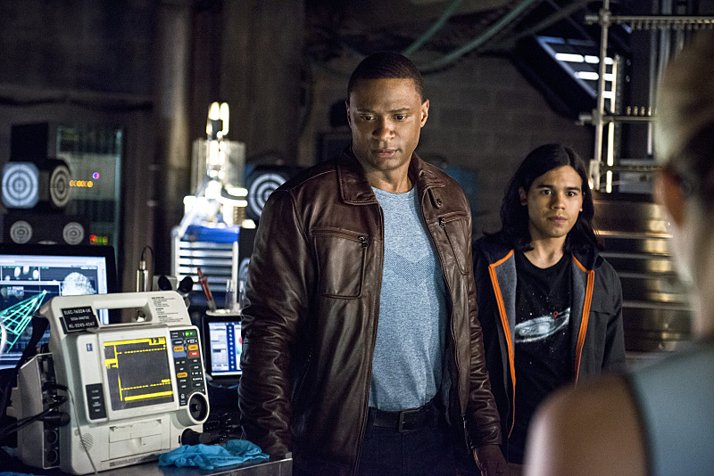 "Arrow -- ""The Brave and the Bold"" -- Image AR308b_0209b -- Pictured (L-R): David Ramsey as John Diggle and Carlos Valdes as Cisco Ramon -- Photo: Cate Cameron/The CW -- © 2014 The CW Network, LLC. All Rights Reserved."