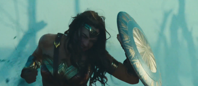 wonder-woman-trailer-screenshots---gal-gadot-hero-pose-with-shie-191875